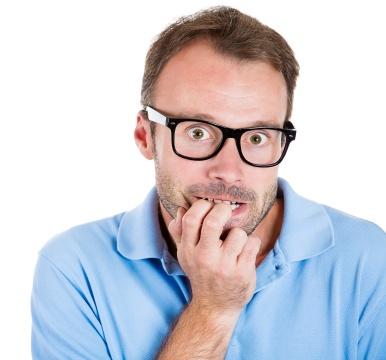 Anxious, nervous man biting his fingernails, craving something