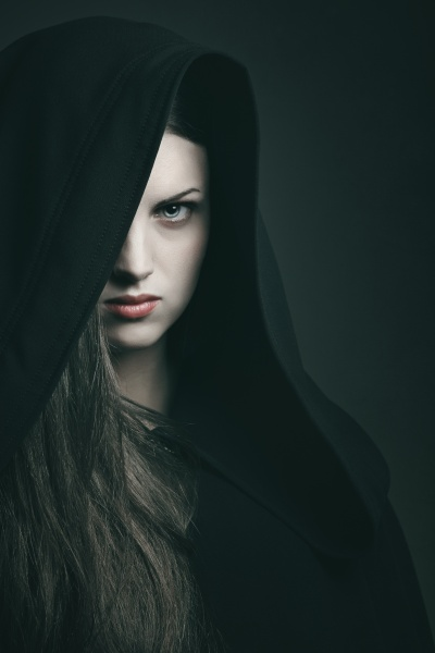 Beautiful vampire with black robe