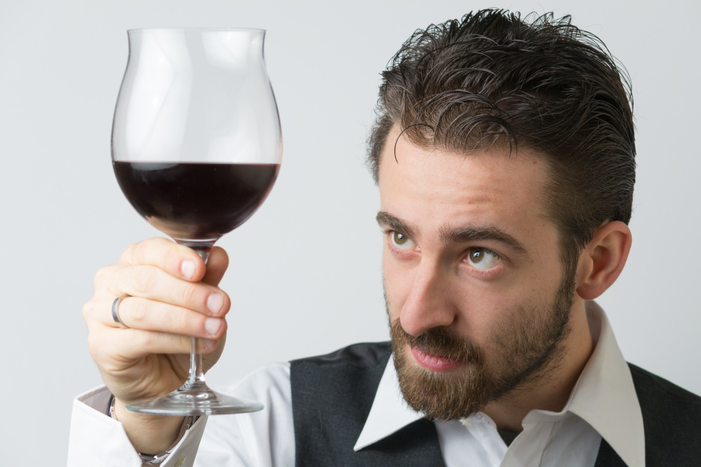 Winemaker with wine glass.